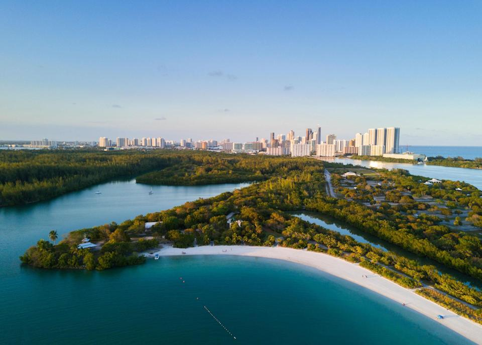 "<p>Florida's largest urban park reveals a glimpse of old Miami with a natural mix of tidal mangroves, small islands, and sandbars, all strewn throughout Biscayne Bay. Kayak under a mangrove canopy to reach Sandspur Island and claim your own small stretch of beach under the palm trees. (But beware: You are not alone, and Sandspur's raccoons are notorious for stealing things.) Alternatively, walk, drive, or paddle to Oleta's shallow beach cove, a great depth for wading and for young children to splash around.</p> <p><strong>Who it's best for:</strong> Kayakers, adventure-seekers, and families who want more than an ordinary beach experience</p> <p><strong>The vibe:</strong> Nature buffs finding their niche in Miami's beach scene</p> <p><strong>What to do:</strong> Within the park, follow the signs to the <a href=""https://oletariveroutdoors.com"" rel=""nofollow noopener"" target=""_blank"" data-ylk=""slk:Outdoor Center"" class=""link rapid-noclick-resp"">Outdoor Center</a> to rent your own kayak or sign up for a group tour.</p>"