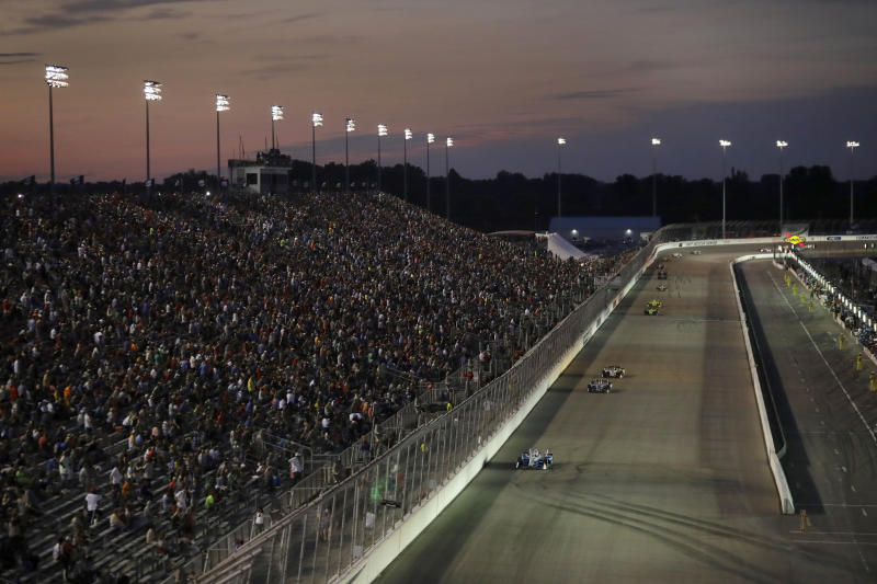 Josef Newgarden, bottom, leads early during the IndyCar auto race at World Wide Technology Raceway on Saturday, Aug. 24, 2019, in Madison, Ill. (AP Photo/Jeff Roberson)
