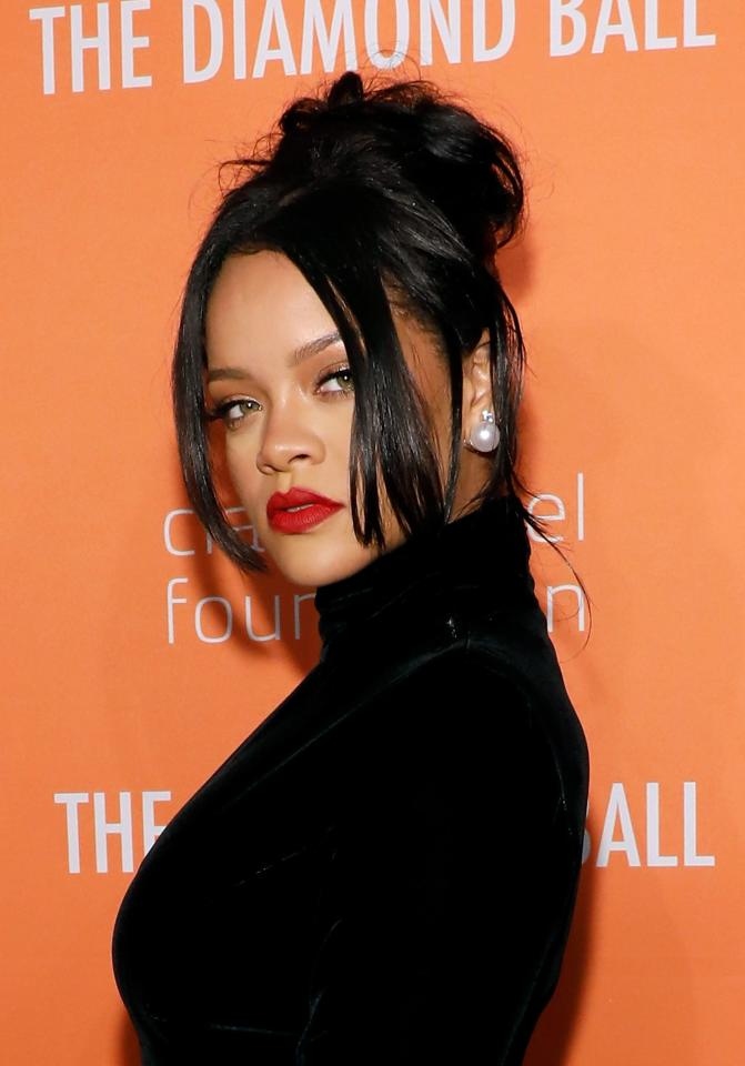 <p>Rihanna, master of looking effortlessly cool, wore her hair in a messy top knot at her 2019 Diamond Ball. </p>