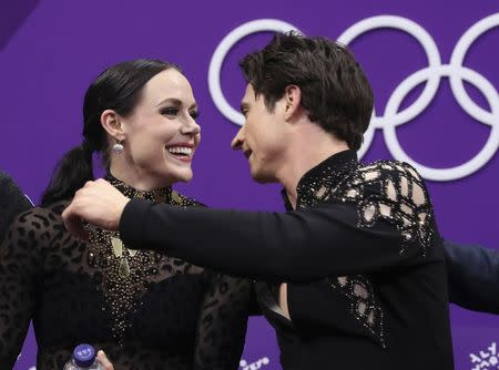 Figure Skating - Pyeongchang 2018 Winter Olympics - Ice Dance short dance competition - Gangneung Ice Arena - Gangneung, South Korea - February 19, 2018 - Tessa Virtue and Scott Moir of Canada react to their score. REUTERS/Lucy Nicholson