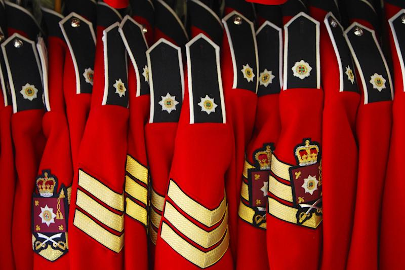Home Service tunics of the Irish Guards on a rack at their barracks in Windsor, as they prepare for their ceremonial duties during the wedding of Prince William and Kate Middleton next week.