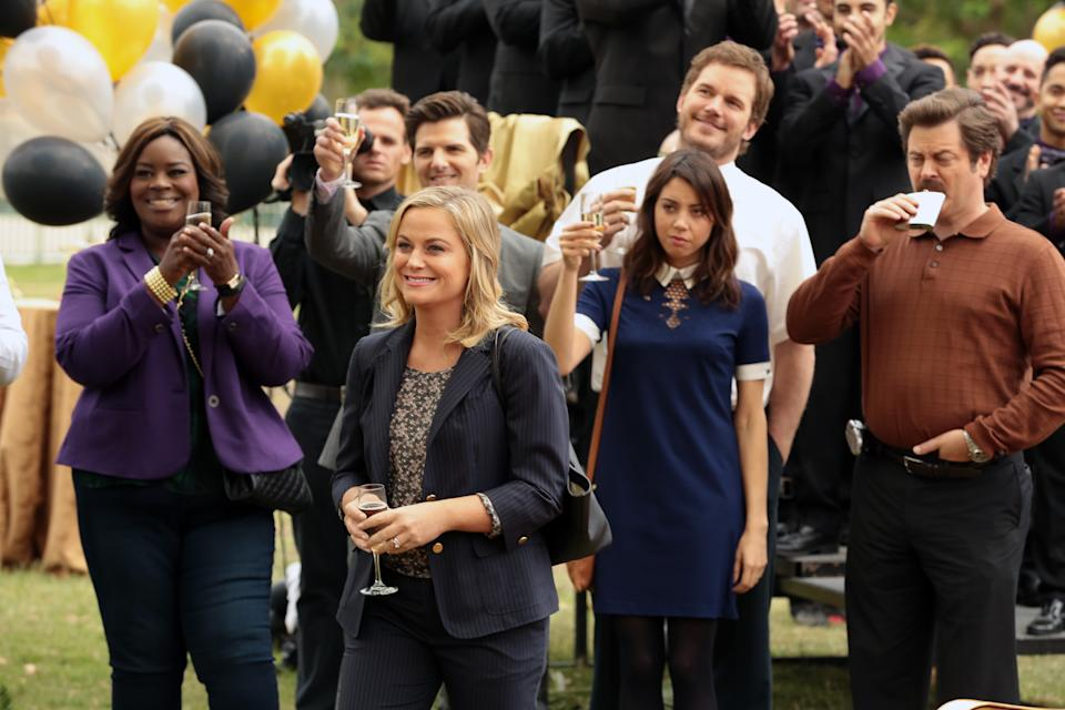 """PARKS AND RECREATION -- """"Viva Gunderson!"""" Episode 711 -- Pictured: (l-r) Retta as Donna Meagle, Adam Scott as Ben Wyatt, Amy Poehler as Leslie Knope, Aubrey Plaza as April Ludgate, Nick Offerman as Ron Swanson -- (Photo by: Chris Haston/NBCU Photo Bank/NBCUniversal via Getty Images via Getty Images)"""