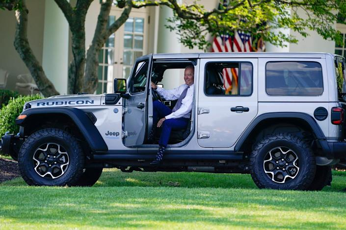 President Joe Biden sits in a Jeep Wrangler Rubicon 4xE during an event on clean cars and trucks, on the South Lawn of the White House on Aug. 5, 2021, in Washington.