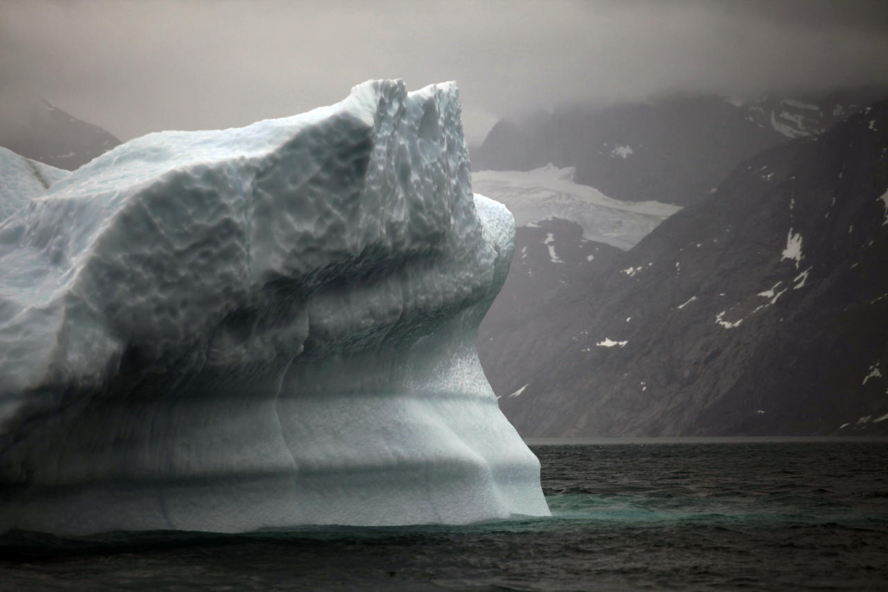 In this July 26, 2011 photo, a melting iceberg floats along a fjord leading away from the edge of the Greenland ice sheet near Nuuk, Greenland. (AP Photo/Brennan Linsley)