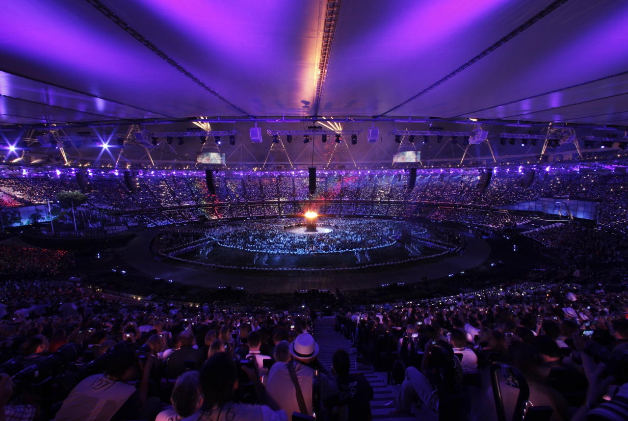 The Olympic torch is lit during the Opening Ceremony at the 2012 Summer Olympics, Friday, July 27, 2012, in London. (AP Photo/Charlie Riedel)