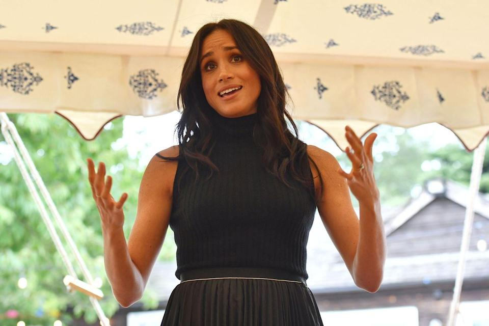 """<p>It seems like Meg has actually worn the style on more than one occasion. She slipped into a sleeveless cashmere one by the same label to <a href=""""https://www.cosmopolitan.com/entertainment/a23276040/meghan-markle-cookbook/"""" rel=""""nofollow noopener"""" target=""""_blank"""" data-ylk=""""slk:celebrate the publication of"""" class=""""link rapid-noclick-resp"""">celebrate the publication of </a><em><a href=""""https://www.cosmopolitan.com/entertainment/a23276040/meghan-markle-cookbook/"""" rel=""""nofollow noopener"""" target=""""_blank"""" data-ylk=""""slk:Together: Our Community Cookbook"""" class=""""link rapid-noclick-resp"""">Together: Our Community Cookbook</a></em> in September 2018.</p>"""