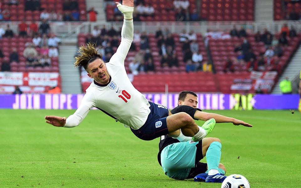 England's Jack Grealish in action with Austria's Stefan Lainer - REUTERS