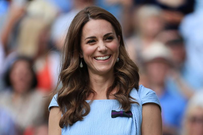 The Duchess of Cambridge laughs and smiles on Day 13 of The Championships - Wimbledon 2019 at the All England Lawn Tennis and Croquet Club on July 14, 2019 in London, England. (Photo: Simon Stacpoole/Offside via Getty Images)
