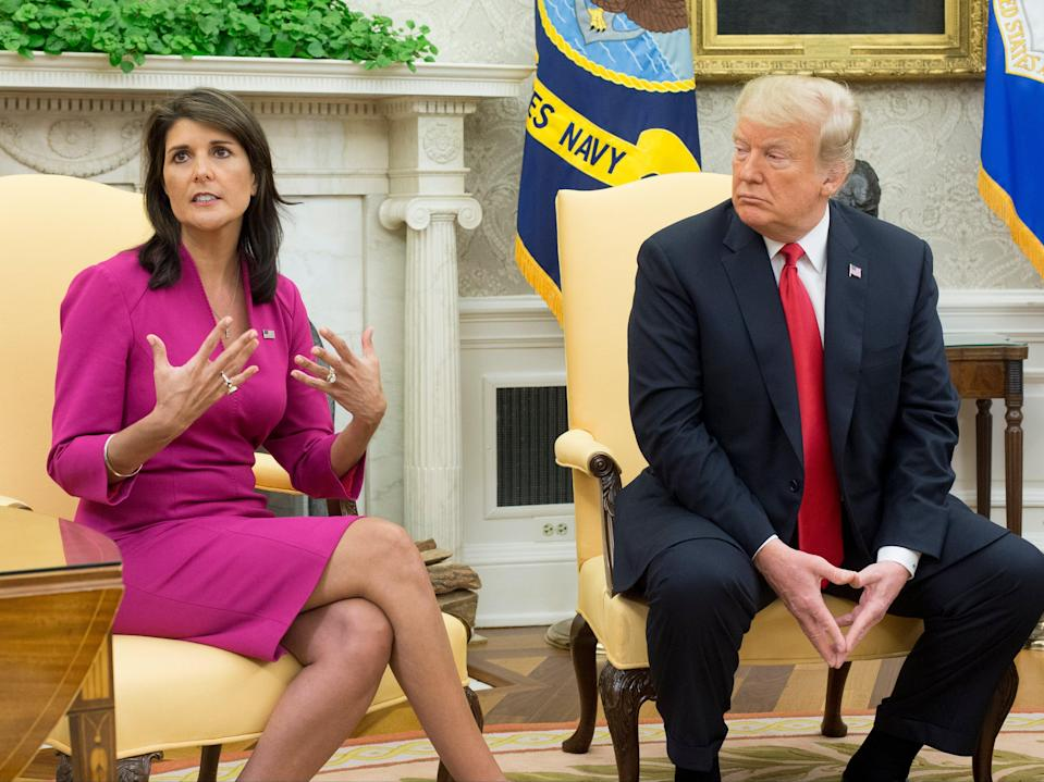 <p>Nikki Haley (L) speaks beside US President Donald J Trump (R) in the Oval Office of the White House in Washington, DC, on 9 October 2018</p> ((EPA))