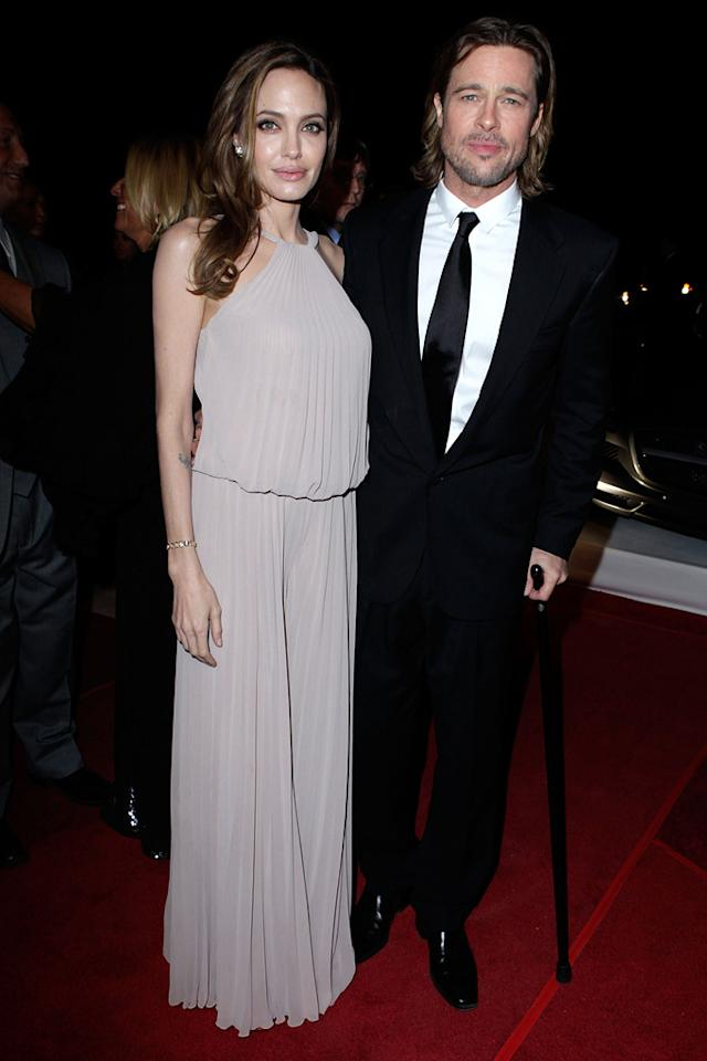 "<a href=""http://movies.yahoo.com/movie/contributor/1800019275"">Angelina Jolie</a> and <a href=""http://movies.yahoo.com/movie/contributor/1800018965"">Brad Pitt</a> attend the 23rd Annual Palm Springs Film Festival awards gala on January 7,2012."