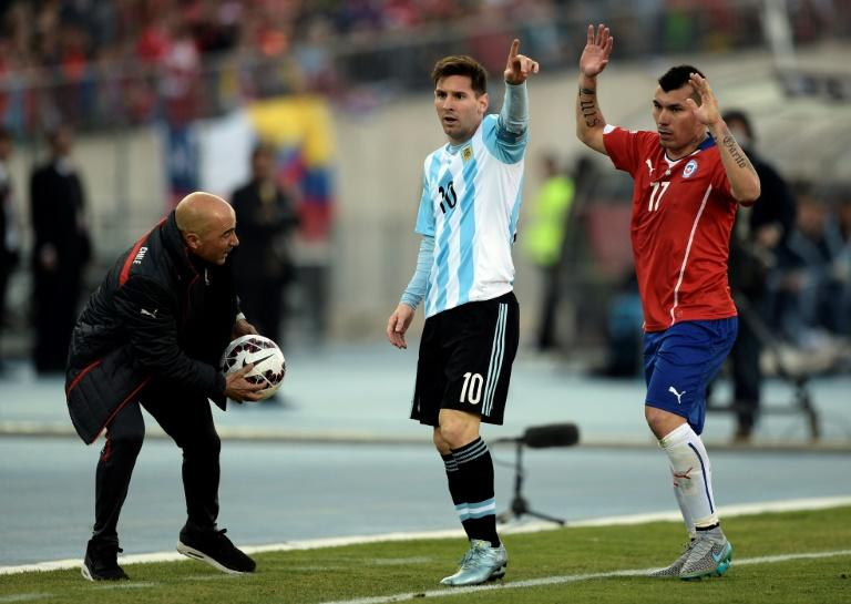Argentina's Lionel Messi (C) and Chile's Gary Medel (R) gesture next to then Chile's coach Jorge Sampaoli during their 2015 Copa America final match