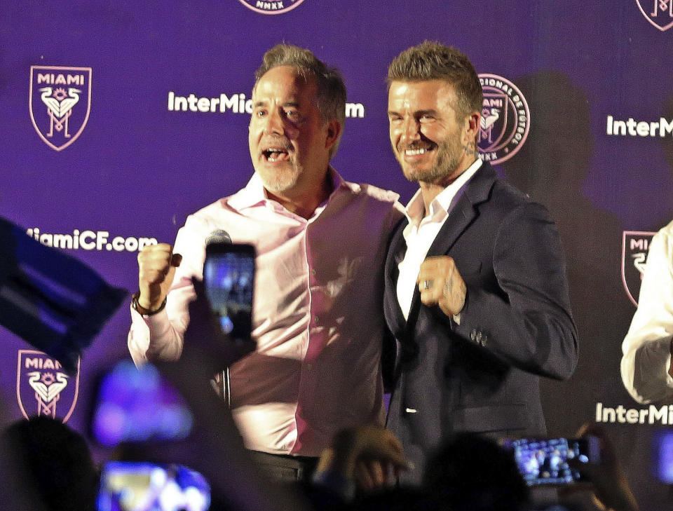 Jorge Mas, left, and David Beckham celebrate after Miami voters gave city officials permission Tuesday to negotiate a no-bid lease deal with Beckham's group, which wants to build a Major League Soccer complex on what has been a public golf course. (Charles Trainor Jr./Miami Herald via AP)