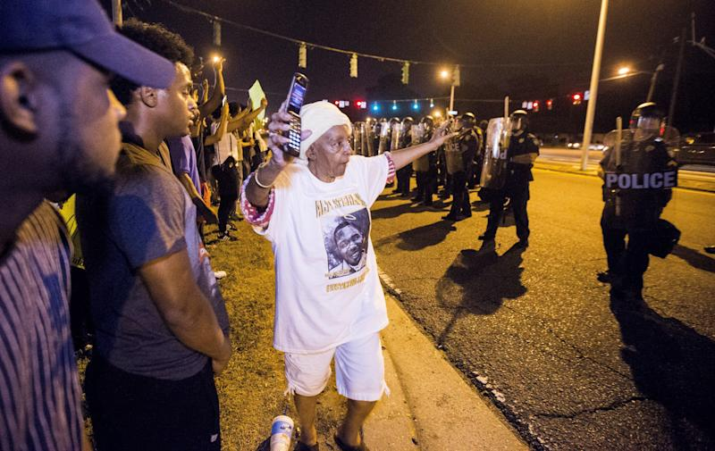 BATON ROUGE, LA -JULY 10: People gather to protest the shooting of Alton Sterling on July 10, 2016 in Baton Rouge, Louisiana. Alton Sterling was shot by a police officer in front of the Triple S Food Mart in Baton Rouge on July 5th, leading the Department of Justice to open a civil rights investigation. (Photo by Mark Wallheiser/Getty Images)