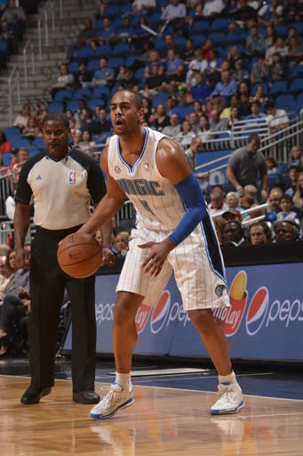ORLANDO, FL - DECEMBER 29: Arron Afflalo #4 of the Orlando Magic looks to pass the ball against the Atlanta Hawks during the game on December 29, 2013 at Amway Center in Orlando, Florida. (Photo by Fernando Medina/NBAE via Getty Images)