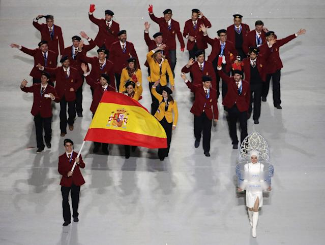 Javier Fernandez of Spain holds the national flag and enters the arena with his teammates during the opening ceremony of the 2014 Winter Olympics in Sochi, Russia, Friday, Feb. 7, 2014. (AP Photo/Charlie Riedel)