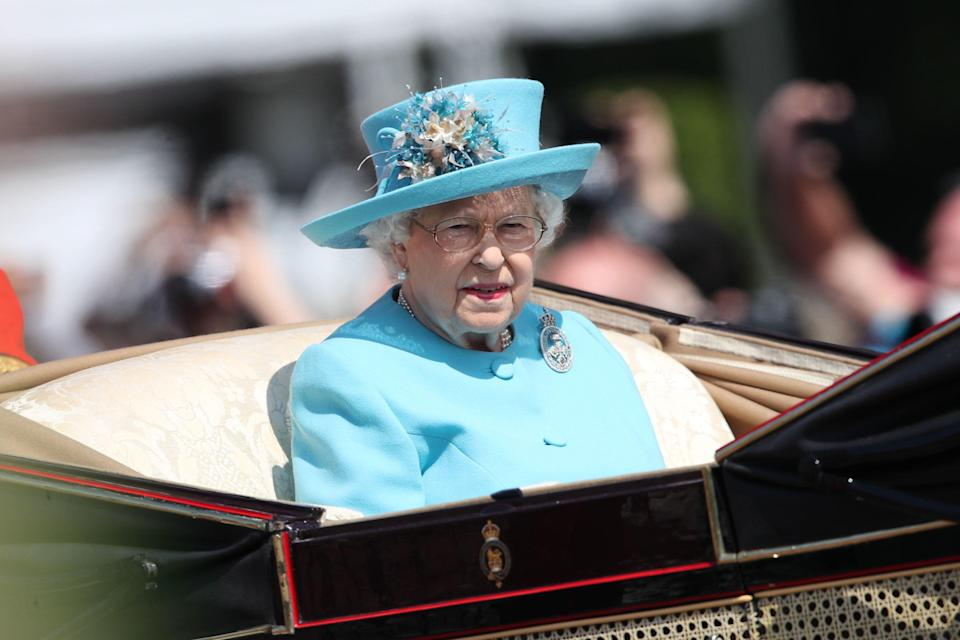 <p>The woman of the hour wore a bright turquoise Stewart Parvin number and an Angela Kelly hat for her birthday celebrations. [Photo:<em> PA]</em> </p>
