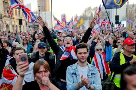 FILE PHOTO: Pro-Brexit protesters gesture and wave flags outside the Houses of Parliament in London