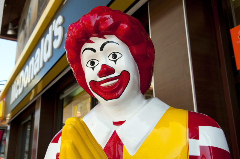 """Chiang Mai, Thailand - November 27, 2011: Ronald McDonald doing a Thai wai greeting outside a McDonalds restaurant in this northern Thai city."""