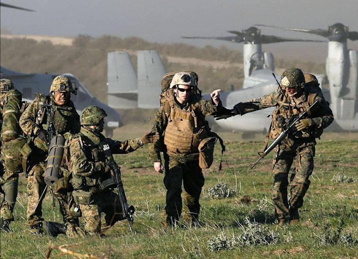 In this Feb. 13, 2013 photo, Japanese Ground Self-Defense Force soldiers and U.S. Marine take part in the U.S.-Japan joint military drill at the Camp Pendleton Marine Corps base, California. Japanese troops will converge on California's southern coast in the next two weeks, the middle of June 2013, as part of a military exercise with U.S. troops aimed at improving that country's amphibious attack abilities. (AP Photo/Kyodo News) JAPAN OUT, MANDATORY CREDIT