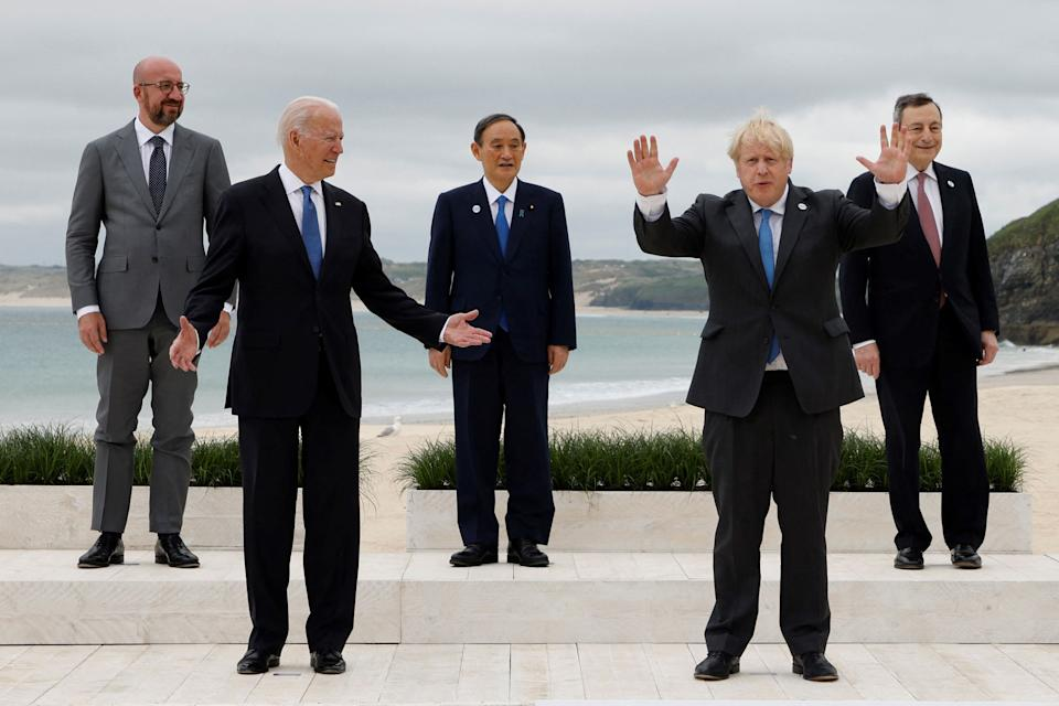 (L-R) President of the European Council Charles Michel, US President Joe Biden, Japan's Prime Minister Yoshihide Suga, Britain's Prime Minister Boris Johnson and Italy's Prime minister Mario Draghi pose for the family photo at the start of the G7 summit in Carbis Bay, Cornwall on June 11, 2021. - G7 leaders from Canada, France, Germany, Italy, Japan, the UK and the United States meet this weekend for the first time in nearly two years, for three-day talks in Carbis Bay, Cornwall. - (Photo by Ludovic MARIN / AFP) (Photo by LUDOVIC MARIN/AFP via Getty Images)