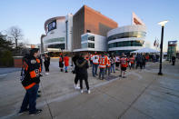 Fans line up outside the Wells Fargo Center before an NHL hockey game between the Philadelphia Flyers and the Washington Capitals, Sunday, March 7, 2021, in Philadelphia. (AP Photo/Matt Slocum)