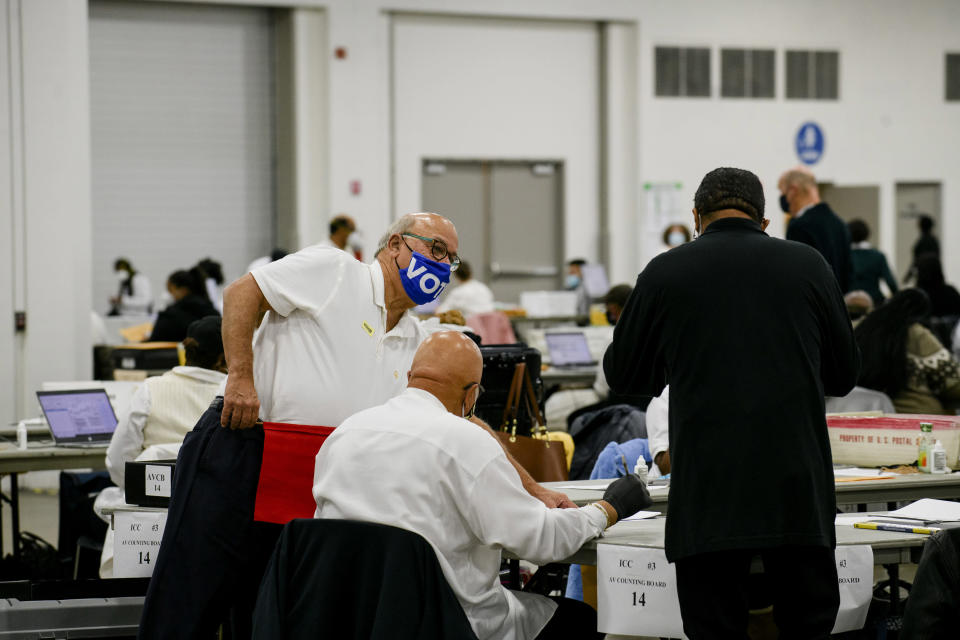 Workers with the Detroit Department of Elections count absentee ballots in the city on Wednesday morning, Nov. 4 2020. (Brittany Greeson/The New York Times)