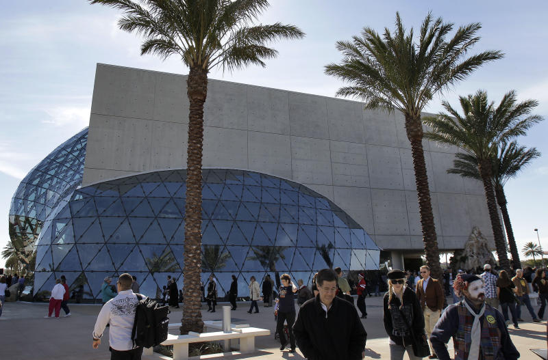 "In this Jan. 11, 2011 photo, Visitors walk outside the new Salvador Dali museum after grand opening ceremonies in St. Petersburg, Fla. Twelve pieces by Salvador Dali are on display at the Florida museum until March 31, 2013 in a show called ""The Royal Inheritance: Dalì Works From the Spanish National Collection."" The paintings, which span from 1918 to 1983, have never before been exhibited the United States. (AP Photo/Chris O'Meara)"