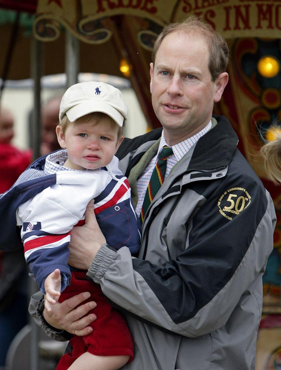 """<p>Prince Edward holds his son <a href=""""https://www.cosmopolitan.com/entertainment/celebs/a35337471/james-viscount-severn-facts/"""" rel=""""nofollow noopener"""" target=""""_blank"""" data-ylk=""""slk:James, Viscount Severn"""" class=""""link rapid-noclick-resp"""">James, Viscount Severn</a>, 17 months, while taking in the sights and sounds of the annual Royal Windsor Horse Show in Windsor. James is currently eleventh-in-line to the royal throne, following Edward (tenth).</p>"""