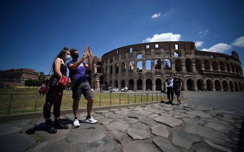 The Colosseum in Rome has reopened as Italy returns to life as usual - AFP