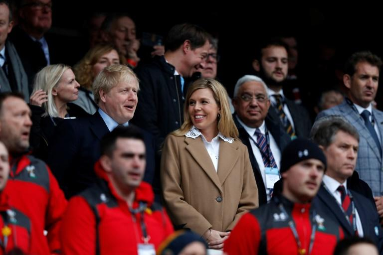 Prime Minister Boris Johnson and his then pregnant girlfriend Carrie Symonds attended a Six Nations match between England and Wales on March 7 (AFP Photo/ADRIAN DENNIS)