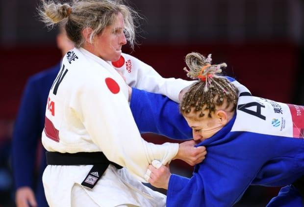 Canada's Priscilla Gagnécompetes against Cherine Abdellaoui of Algeria in the gold-medal bout of the women's 52-kilogram judo event.  (Thomas Peter/Reuters - image credit)