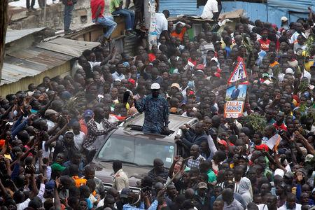 Opposition leader Raila Odinga greets supporters in Nairobi