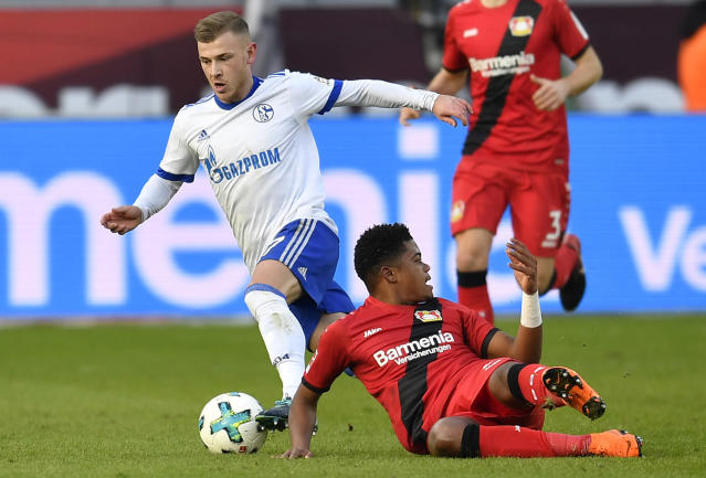 Schalke's Max Meyer wins the ball against Leverkusen's Leon Bailey during the German Bundesliga soccer match between Bayer Leverkusen and FC Schalke 04 in Leverkusen, Germany, Sunday, Feb 25, 2018. (AP Photo/Martin Meissner)