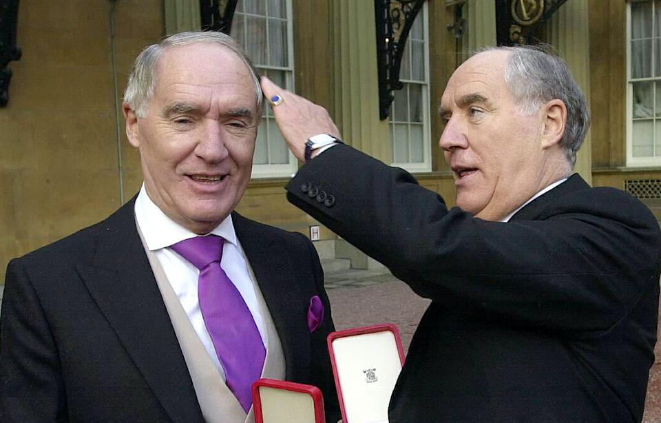 Sir David Barclay, left, and his twin brother Sir Frederick after receiving their knighthoods from the Queen at Buckingham Palace. Photo: PA