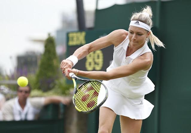 Maria Kirilenko of Russia plays a return to Sloane Stephens of U.S. during their first round match at the All England Lawn Tennis Championships in Wimbledon, London, MondayJune 23, 2014. (AP Photo/Pavel Golovkin)