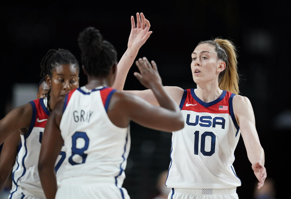United States' Breanna Stewart (10), right, celebrates with teammates after their win in the women's basketball preliminary round game against Japan at the 2020 Summer Olympics, Friday, July 30, 2021, in Saitama, Japan. (AP Photo/Charlie Neibergall)