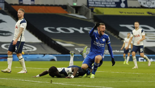 Leicester's Jamie Vardy, right reacts and celebrates after Tottenham's Toby Alderweireld, left scored an own goal for Leicester's second goal of the game during the English Premier League soccer match between Tottenham Hotspur and Leicester City at the White Hart Lane stadium in London Sunday, Dec. 20, 2020. (AP Photo/Frank Augstein, Pool)