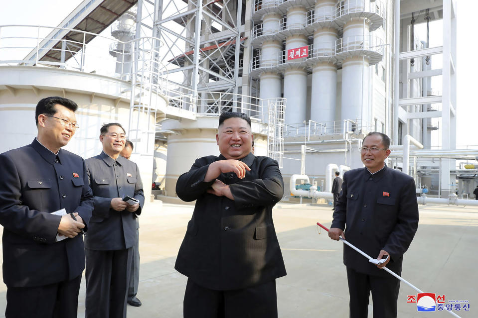 "ADDING CITY - In this Friday, May 1, 2020, photo provided by the North Korean government, North Korean leader Kim Jong Un, center, visits a fertilizer factory in Sunchon, South Pyongan province, near Pyongyang, North Korea. Kim made his first public appearance in 20 days as he celebrated the completion of the fertilizer factory, state media said Saturday, May 2, 2020, ending an absence that had triggered global rumors that he may be seriously ill. Independent journalists were not given access to cover the event depicted in this image distributed by the North Korean government. The content of this image is as provided and cannot be independently verified. Korean language watermark on image as provided by source reads: ""KCNA"" which is the abbreviation for Korean Central News Agency. (Korean Central News Agency/Korea News Service via AP)"