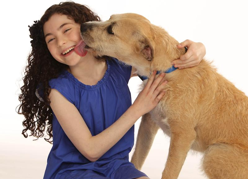 """This photo provided by Boneau/Bryan-Brown shows Lilla Crawford, who will play the role of Annie, and """"Sunny"""" who will play the role of Sandy, in the new Broadway production of Annie. Previews begin October 3 and opening night is November 8 at the Palace Theatre. (AP Photo/Boneau/Bryan-Brown, Joan Marcus)"""