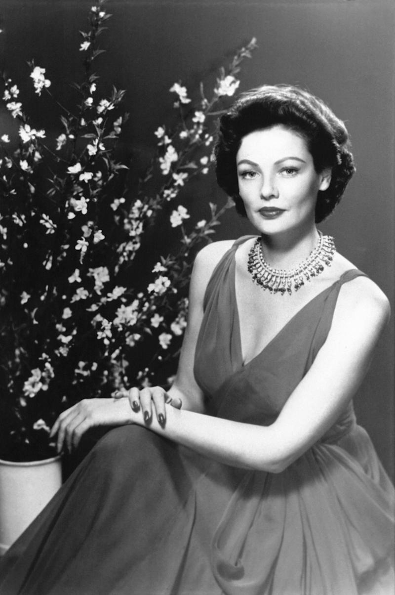 The actress wears a low-cut dress and statement necklace in this undated photo.