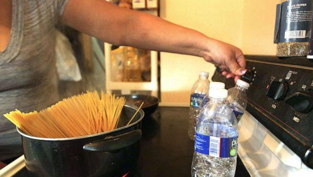 PHOTO: Jamie Marshall says she won't use the water in Flint, Mich., for cooking, so she uses four bottles of water to boil spaghetti for dinner. (Janet Weinstein/ABC News)