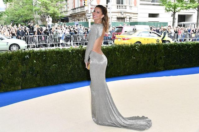 <p>The supermodel and co-chair of the 2017 Met Gala wore a sustainable, backless metallic gown by designer Stella McCartney. She styled her hair in a high ponytail. (Photo: Rob Latour/REX) </p>