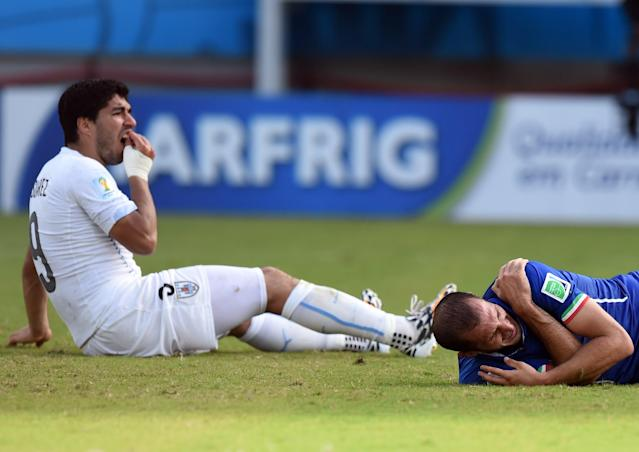 Luis Suarez and Giorgio Chiellini react to the former's bite in the 2014 tournament