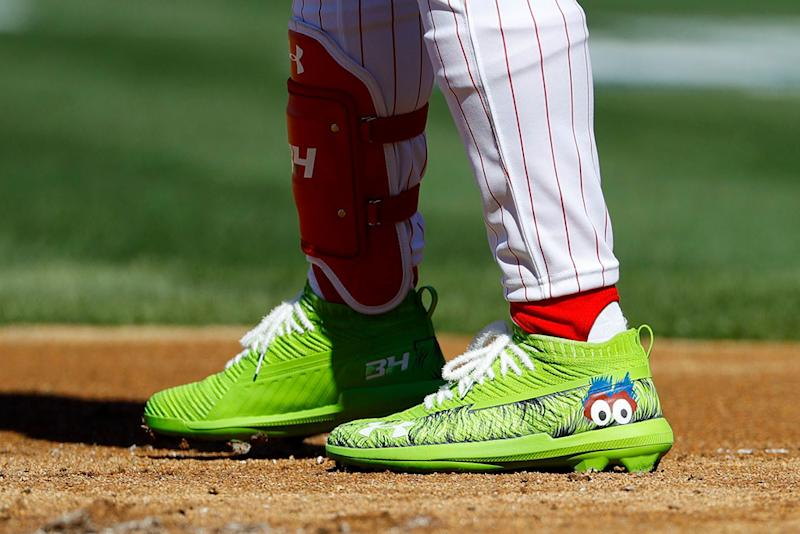 The cleats of Philadelphia Phillies' Bryce Harper are seen during the first inning of an opening day baseball game against the Atlanta Braves, in PhiladelphiaBraves Phillies Baseball, Philadelphia, USA - 28 Mar 2019