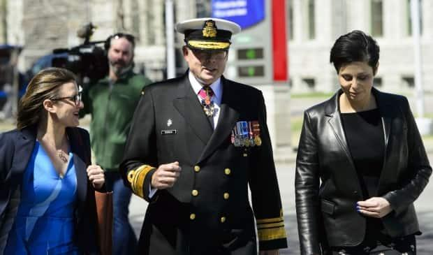Vice-Admiral Mark Norman walks with his lawyers Marie Henein (right) and Christine Mainville as they leave court in Ottawa on Wednesday, May 8, 2019.