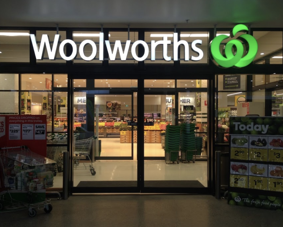 Photo shows front of a Woolworths store.
