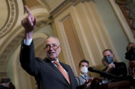 Senate Majority Leader Chuck Schumer, D-N.Y., takes questions as he speaks to reporters after a weekly policy meeting, at the Capitol in Washington, Tuesday, Sept. 21, 2021. (AP Photo/J. Scott Applewhite)