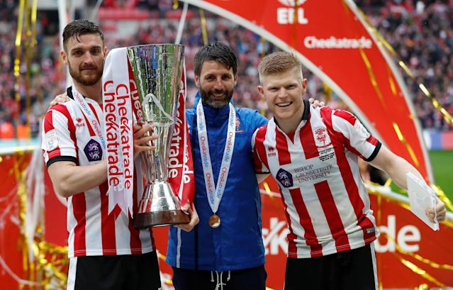 "Soccer Football - Checkatrade Trophy Final - Lincoln City vs Shrewsbury Town - Wembley Stadium, London, Britain - April 8, 2018 Lincoln CityÕs Luke Waterfall (L) manager Danny Cowley and Elliot Whitehouse (R) with the trophy Action Images/Matthew Childs EDITORIAL USE ONLY. No use with unauthorized audio, video, data, fixture lists, club/league logos or ""live"" services. Online in-match use limited to 75 images, no video emulation. No use in betting, games or single club/league/player publications. Please contact your account representative for further details."