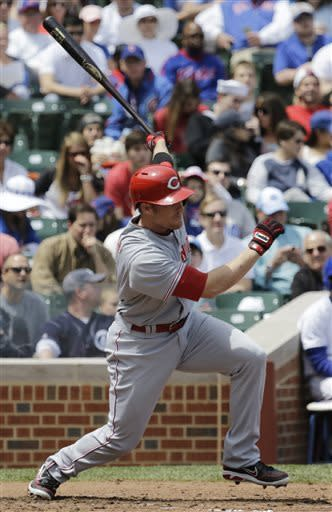 Cincinnati Reds' Zack Cozart hits an RBI single against the Chicago Cubs during the first inning of a baseball game in Chicago, Saturday, May 4, 2013. (AP Photo/Nam Y. Huh)