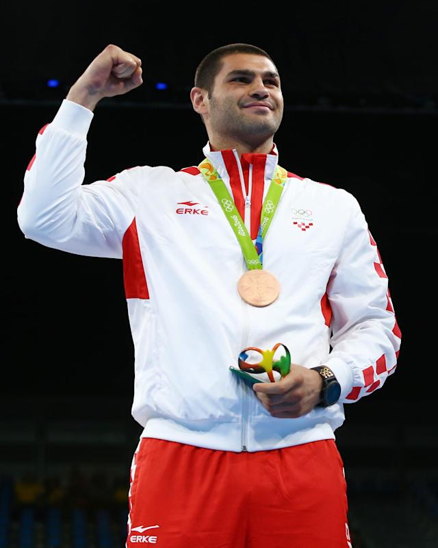 2016 Rio Olympics - Boxing - Victory Ceremony - Men's Super Heavy (+91kg) Victory Ceremony - Riocentro - Pavilion 6 - Rio de Janeiro, Brazil - 21/08/2016. Bronze medallist Filip Hrgovic (CRO) of Croatia poses with his medal. REUTERS/Peter Cziborra FOR EDITORIAL USE ONLY. NOT FOR SALE FOR MARKETING OR ADVERTISING CAMPAIGNS.